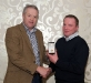 eamonn-hassan-receives-his-award-from-ulster-gaa-vice-chairman-martin-mcaviney