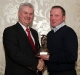 eamonn-hassan-receives-his-ushc-final-award-from-ulster-gaa-president-aogan-o-fearghail
