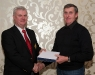 hugh-pat-mccusker-receives-his-award-from-ulster-gaa-president-aogan-o-fearghail