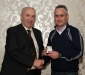 michael-mcglinchey-receives-his-award-from-ulster-gaa-secretary-danny-murphy