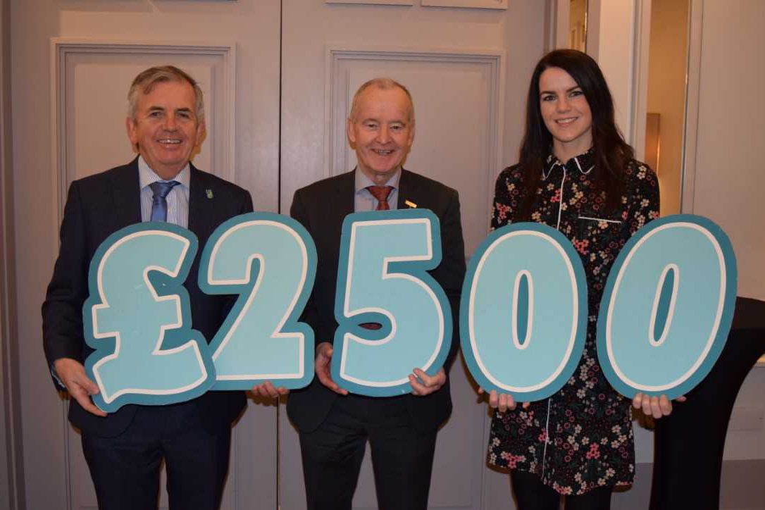 Ulster GAA make presentation to Cancer Focus NI